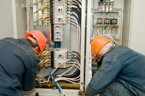 Commercial Electricians at Work on an Industrial Panel